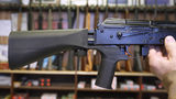 A bump stock device (left) that fits on a semi-automatic rifle to increase the firing speed, making it similar to a fully automatic rifle, is installed on a AK-47 semi-automatic rifle, (right) at a gun store on October 5, 2017 in Salt Lake City, Utah