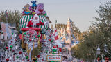 Santa Claus waves to Disneyland guests from his sleigh during the seasonal A Christmas Fantasy parade, performed daily at Disneyland Park.