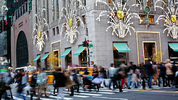NEW YORK - NOVEMBER 27: Shoppers walk by holiday decor hanging on Tiffany & Co. in New York City on Black Friday, November 27, 2015.