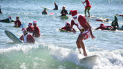 This year thousands showed up in downtown Cocoa Beach for the annual Christmas Eve Surfing Santas event.