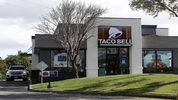 Police in Oklahoma City said a man fired two shots into a drive-thru window at a Taco Bell.