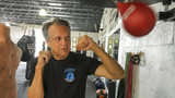 Steve Shepherd, a world champion kickboxer, works out in West Palm Beach, Fla. Shepherd was limping to his car last week, a pulled muscle impairing his stride, when a mugger hit him in the head with a bottle and demanded his cellphone.