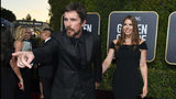 Christian Bale, left, gestures as he and Sibi Blazic arrive at the 76th annual Golden Globe Awards at the Beverly Hilton Hotel on Sunday, Jan. 6, 2019, in Beverly Hills, Calif.
