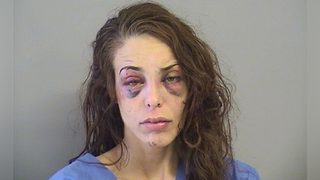 Woman tried to break into home, assault residents with knives, bat, police say