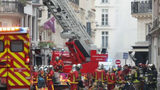 Firefighters work at the scene of a gas leak explosion in Paris on Saturday morning.