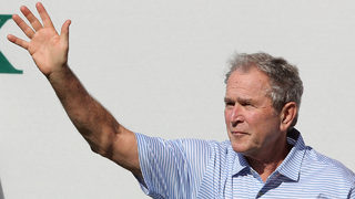 George W. Bush delivers pizza, calls for