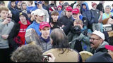 """In this Friday, Jan. 18, 2019 image made from video provided by the Survival Media Agency, a teenager wearing a """"Make America Great Again"""" hat, center left, stands in front of an elderly Native American singing and playing a drum in Washington."""