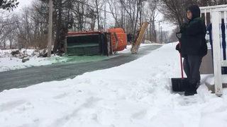 Snow plow flips on steep Massachusetts street
