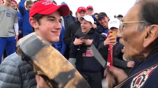 Teens wearing red MAGA hats taunt Native American vet during march