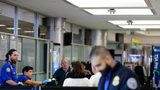 FILE PHOTO: Passengers stand in line as they wait to pass through a Transportation Security Administration checkpoint at LaGuardia airport Monday, Jan. 7, 2019, in New York.