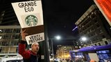 David Schwartz, of Bellevue, Wash., yells as he takes part in a protest outside a book-promotion event held by former Starbucks CEO Howard Schultz, Thursday, Jan. 31, 2019, in Seattle.