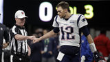 Referee John Parry, left, bumps fists with New England Patriots' Tom Brady before the NFL Super Bowl 53 football game between the Patriots and the Los Angeles Rams, Sunday, Feb. 3, 2019, in Atlanta.
