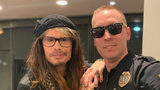 A police officer in Tennesse snapped a photo with Steven Tyler when they happened to be at the same Starbucks.