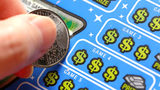 FILE PHOTO: An Illinois man said he played his first scratch off ticket and won $20,000 a week for 20 years.