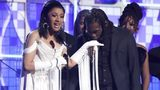 "Cardi B, left, accepts the award for best rap album for ""Invasion of Privacy"" as Offset kisses her hand at the 61st annual Grammy Awards on Sunday, Feb. 10, 2019, in Los Angeles."