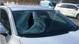 Girl hurt after ice falls off tractor-trailer, smashes windshield