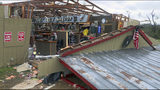 In this Sunday, March 3, 2019 photo, debris litters the Buck Wild Saloon, after it was heavily damaged by a tornado, in Smiths Station, Ala. (Mike Haskey/Ledger-Enquirer via AP)
