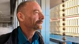 """Timothy Ray Brown poses for a photograph, Monday, March 4, 2019, in Seattle. Brown, also known as the """"Berlin patient,"""" was the first person to be cured of HIV infection, more than a decade ago."""