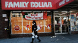 A woman walks by a Family Dollar store on December 11, 2018, in the Brooklyn borough of New York City.