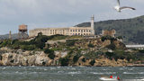 A boat passes in front of Alcatraz Island on April 7, 2011, in San Francisco Bay. The island houses the former Alcatraz Federal Penitentiary, from which three men escaped in 1962 and vanished.