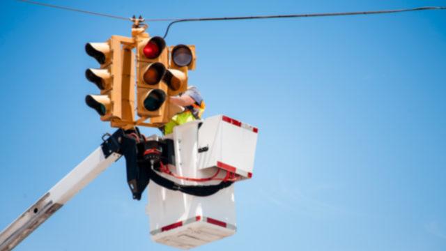 Semi hits bucket truck, ejects man working on traffic signal