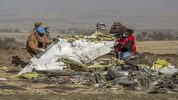 Rescuers work at the scene of an Ethiopian Airlines flight crash near Bishoftu, Ethiopia, Monday, March 11, 2019. The airline has grounded its Boeing 737 Max 8 aircraft as a safety precaution, following a crash that killed 157 people.