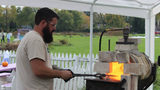 Mike Martin, a Mennonite pastor and blacksmith, works at the forge in Toledo, Ohio.