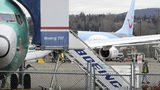 In this Monday, March 11, 2019 file photo, a Boeing 737 MAX 8 airplane being built for TUI Group sits parked in the background at right at Boeing Co.'s Renton Assembly Plant in Renton, Wash. The Transportation Department confirmed that its watchdog