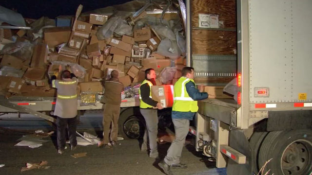 UPS truck crashes, spilling more than 1,000 packages across freeway