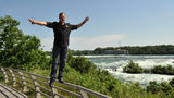 In this handout photo provided by Wallenda Incorporated, Nik Wallenda walks on the railing at Niagara Falls June 14, 2017 in Niagara Falls, New York. Video of a fall months before this photo was taken was released.
