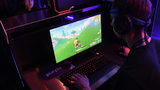 FILE PHOTO: Gamers play 'Fortnite' against Twitch streamer and professional gamer Tyler 'Ninja' Blevins. A teen in New York says he's made $200,000 playing the online game.
