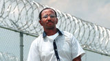 Convicted killer Wayne Williams is pictured in May 1999 near the fence line at Valdosta State Prison in Valdosta, Ga.