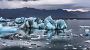 Pieces of blue glacial ice are pictured here. A chunk, similar to one these pieces, broke off a glacier in Iceland, sending tourists running for higher ground. No one was injured. Photo: Pixabay