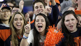 Virginia fans cheer before the championship of the Final Four NCAA college basketball tournament between Texas Tech and Virginia, Monday, April 8, 2019, in Minneapolis. Photo: David J. Phillip/AP