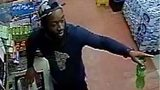Surveillance video shows a man who threw a beer bottle at a convenience store clerk.