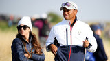 Tiger Woods of the United States watches on with girlfriend Erica Herman during the afternoon foursome matches of the 2018 Ryder Cup at Le Golf National on September 28, 2018 in Paris, France.