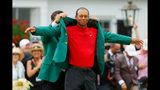 Tiger Woods (R) of the United States is awarded the Green Jacket by Masters champion Patrick Reed (L) during the Green Jacket Ceremony after winning the Masters at Augusta National Golf Club on April 14. (Photo by Kevin C. Cox/Getty Images)