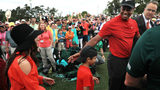 Tiger Woods (R) of the United States celebrates with his girlfriend Erica Herman (L) and son Charlie Axel (C) as he comes off the 18th green in celebration of his win during the final round of the Masters at Augusta National Golf Club on April 14,
