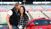 'Fixer Upper' stars Chip and Joanna Gaines pose with the Monster Energy NASCAR Cup Series AAA Texas 500 pace car (Photo by Jared C. Tilton/Getty Images)