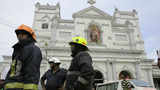 Sri Lankan firefighters stand in the area around St. Anthony's Shrine after a blast in Colombo, Sri Lanka, Sunday, April 21, 2019. Witnesses are reporting two explosions have hit two churches in Sri Lanka on Easter Sunday, causing many casualties.