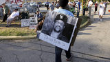 In this Sept. 21, 2011, photo, Ricky Jason wears a photograph of James Byrd Jr. outside the Texas Department of Criminal Justice Huntsville Unit before the execution of Lawrence Russell Brewer in Huntsville, Texas. Photo Credit: David J. Phillip/AP