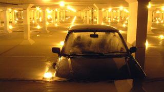 Rain floods Dallas Love Field parking garage, submerges cars