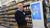 Mike Hanrahan, CEO of Walmart's Intelligent Retail Lab, discusses a kiosk that describes to customers the high technology in use at a Walmart Neighborhood Market, Wednesday, April 24, 2019, in Levittown, N.Y.