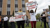 Demonstrators are pictured outside the Waller County Courthouse March 22, 2016, in Hempstead, Texas, during former state Trooper Brian Encinia's arraignment on a perjury charge in the July 10, 2015, arrest of Sandra Bland. AP Photo/David J. Phillips