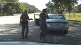 Then-Texas state Trooper Brian Encinia is seen in dashboard camera footage holding a Taser on Sandra Bland July 10, 2015, after forcing her from her car during a traffic stop in Prairie View, Texas. Photo: Texas Department of Public Safety via AP