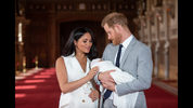 Prince Harry, Duke of Sussex and Meghan, Duchess of Sussex, pose with their newborn son during a photocall in St George's Hall at Windsor Castle on May 8, 2019 in Windsor, England. The Duchess of Sussex gave birth at 05:26 on Monday 06 May, 2019.