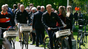 Britain's Prince Harry, right, rides a bicycle during the launch of the 2020 Invictus Games, in The Hague, Netherlands, Thursday, May 9, 2019. Prince Harry returned to his royal duties Thursday after the birth of his son Archie Harrison.