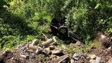 Driver Left Couple Trapped in Vehicle After It Tumbled Down NC Embankment