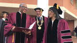 Tech billionaire Robert F. Smith (from left), Morehouse College President David Thomas and actress Angela Bassett prepare to walk to the graduation ceremonies at the college on Sunday, May 19, 2019. Smith and Bassett received honorary degrees.