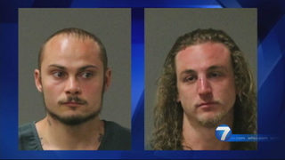 2 surfing on flooded river arrested after asking for help, leaving, police say